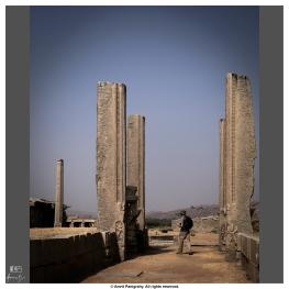 A tourist exploring one of the many ancient gates of Vijaya Vittala temple, Hampi, Karnataka, India