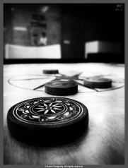 The Striker and the pieces on a carom board