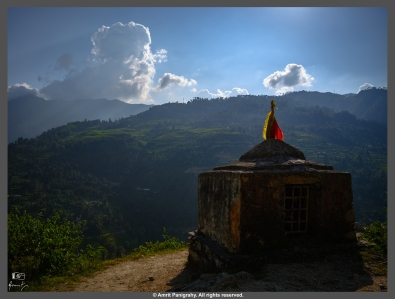 A temple by the mountain road, high in the Himalayas