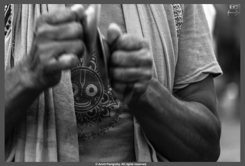 Lord Jagannath on a devotee's t-shirt as he plays his Gini (a traditional Odia music instrument).
