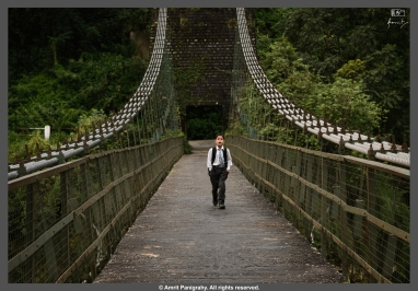 A young man happily going to school on the hanging bridge across Bhagirathi river in Naitala, Uttarakhand